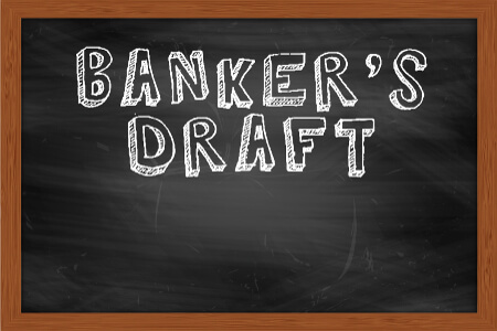 Banker's Draft written on chalk board