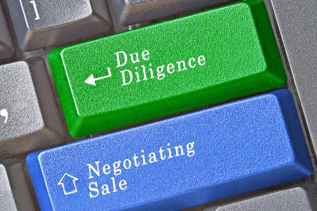 Due Diligence & Negotiating Sale keys on keyboard