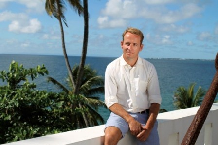 Jonnie Irwin with palm trees and sea